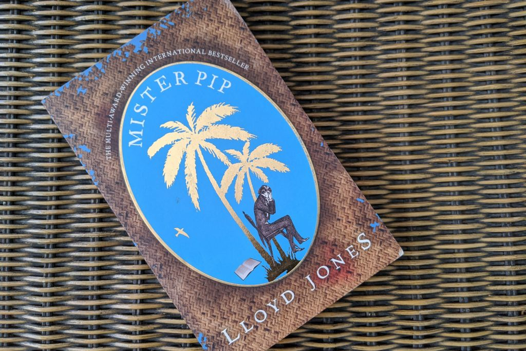 The book Mister Pip flat on a wicker background