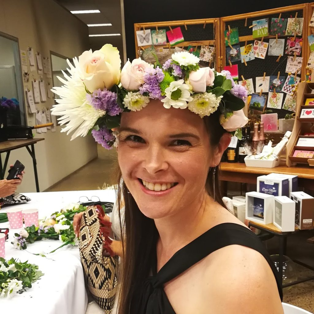Me smiling with an elaborate flower crown.